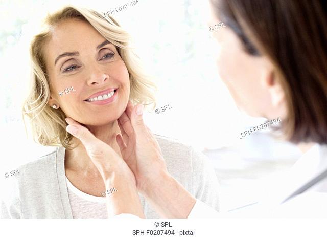 Mature woman having check up in doctor's surgery