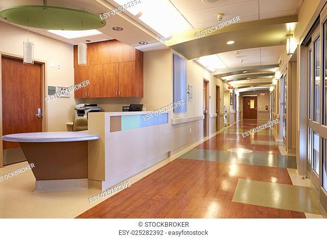 Empty Nurses Station And Corridor In Modern Hospital