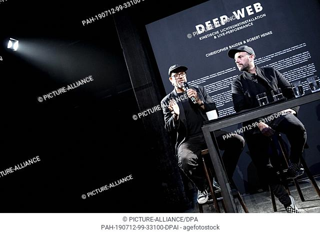12 July 2019, Berlin: Robert Henke (l), composer and musician, and Christopher Bauder, light artist, take part in a press conference at the opening of their...
