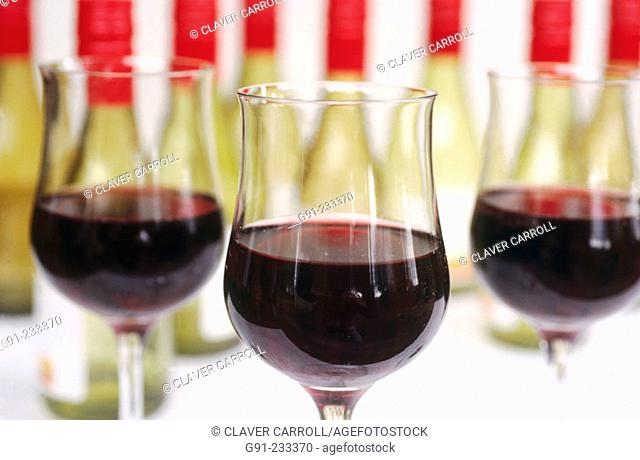 Red wine tasting glasses and bottles