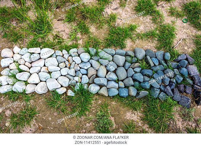 Black white gradient design make of stones, land art