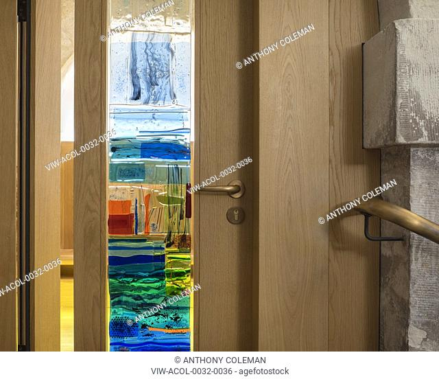 Detail of entrance door to prayer room with staines glass. Crypt of Christ Church Spitalfields, London, United Kingdom. Architect: Dow Jones Architects, 2018