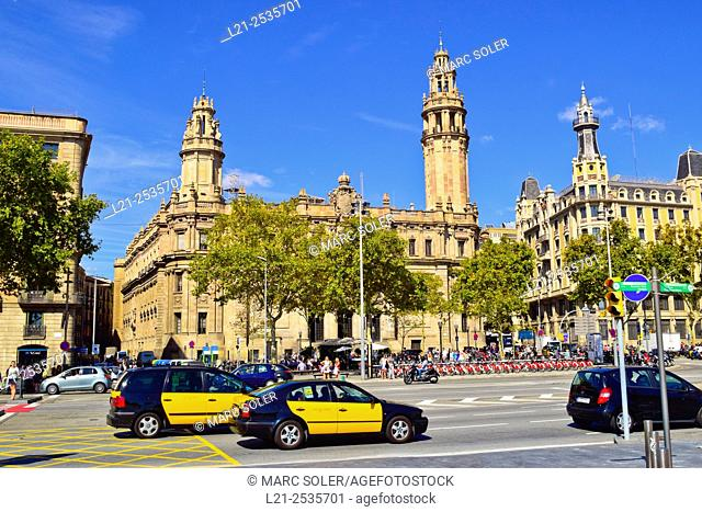 Taxis. Central post office building designed by Josep Goday Casals and Jaume Torres Grau. Plaça Antonio López, Barcelona, Catalonia, Spain