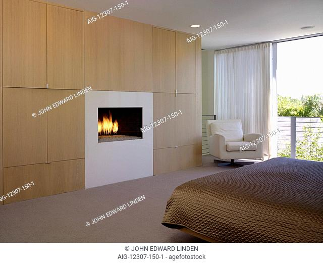 Modern bedroom and fireplace set in cupboards, Lagatutta Residence, Los Angeles, California