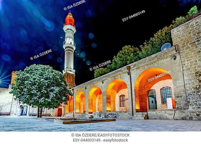 Night view Sehidiye Mosque and Madrassa though arch,a popular landmark in Mardin,Turkey