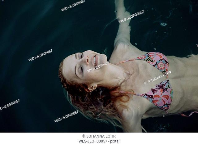 Carefree woman swimming in water