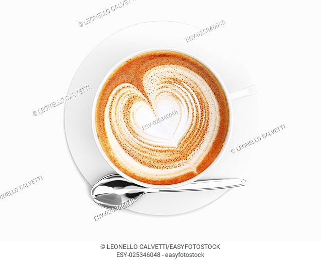 Cappuccino mug close up, with a heart decorated on top of foam. Top view. On white background with clipping path