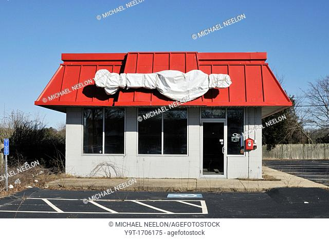 Closed empty fast food style building in Falmouth, Cape Cod, Massachusetts, USA