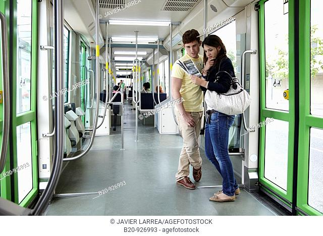 Young couple in tram, Vitoria, Alava, Basque Country, Spain