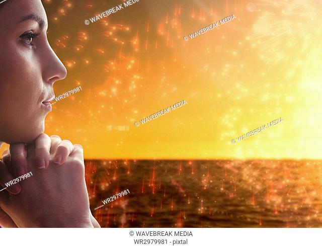 Woman contemplating with firework ocean