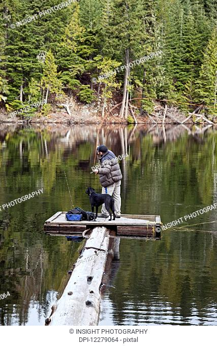 Fly fishing at Loggers Lake; Whistler, British Columbia, Canada