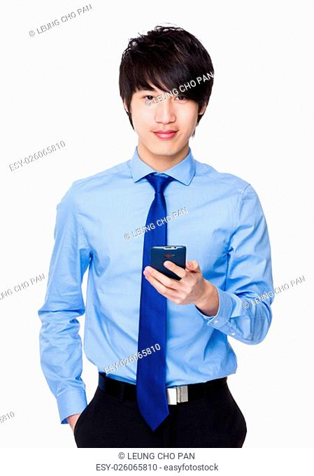 Asian Businessman use of the cellphone