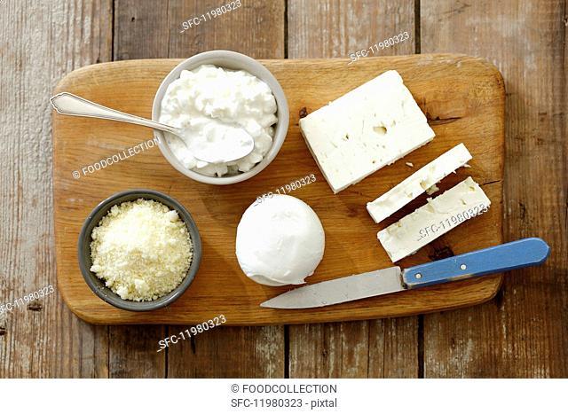 An arrangement of cheese with feta, buffalo mozzarella, cottage cheese and pecorino