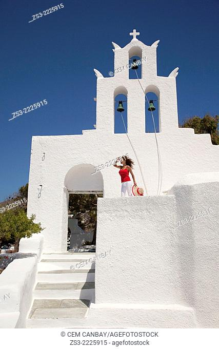 Woman in front of a Cyclades church, Byzantine church of Agia Irini near the Ormos harbour, Ios, Cyclades Islands, Greek Islands, Greece, Europe