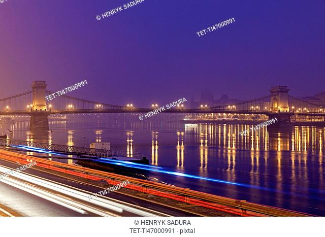 Illuminated Chain Bridge and light trails