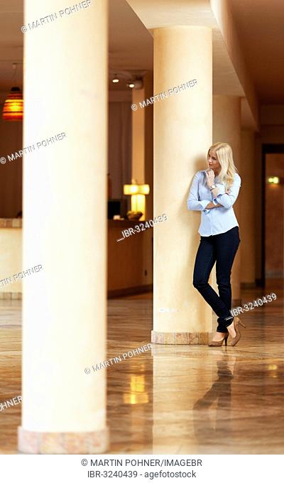 Woman standing in a hotel lobby