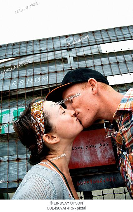 Young couple kissing with eyes closed