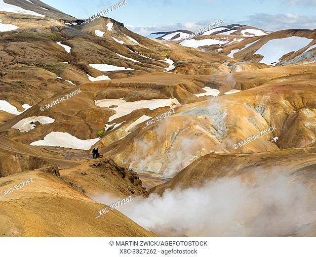 Hikers in the geothermal area Hveradalir in the mountains Kerlingarfjoell in the highlands of Iceland. Europe, Northern Europe, Iceland, August