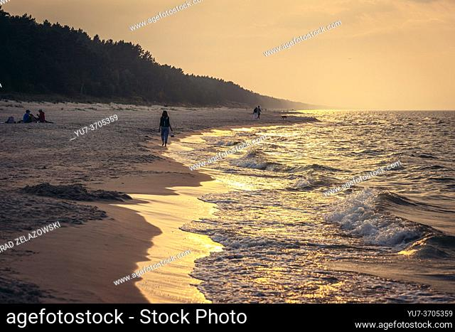 Sunset over beach in Katy Rybackie village on Vistula Spit over Gdansk Bay in the Baltic Sea; Poland