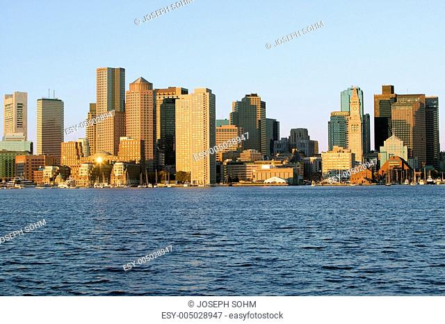 Boston Harbor and the Boston skyline at sunrise as seen from South Boston, Massachusetts, New England