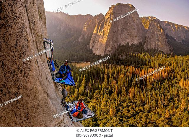 Two rock climbers on portaledges on triple direct, El Capitan, Yosemite Valley, California, USA