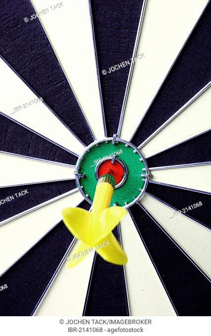 Darts, throwing game, dart sticking into the middle of the dartboard, the bullseye
