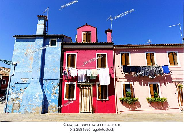 Brightly painted houses in Burano Venice Italy