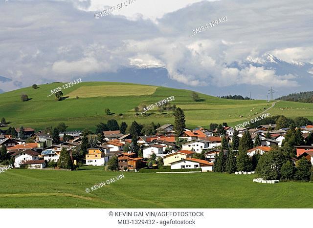 Austria Tirol Tyrol Rinn small town mountain high road pastoral landscape with sheep