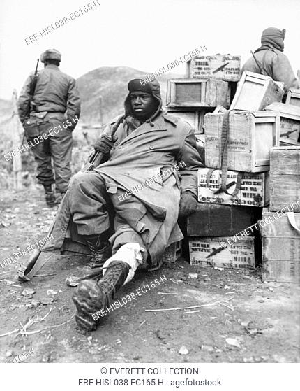 U.S. soldier of the 24th Infantry Regiment wounded in the leg on Feb. 16, 1951. Now regrouped after the failed UN invasion of North Korea
