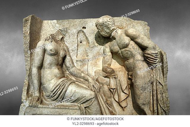 Close up of a Roman Sebasteion relief sculpture of Io and Argos Aphrodisias Museum, Aphrodisias, Turkey. Against a grey background.