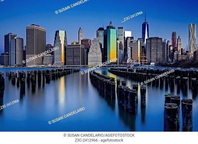 The Sun Rises At The New York City Skyline - The sun begins to rise and bathe the New York City lower Manhattan skyline with it warm golden hues