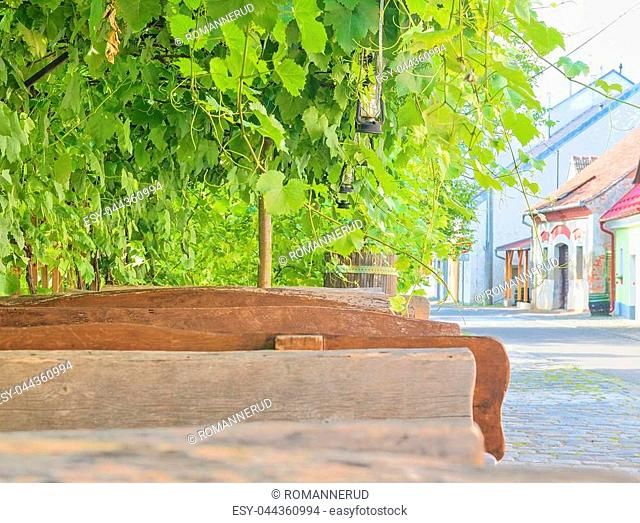 Wine background and benches. View on wine cellars in Europe. Czech Republic, South Moravia