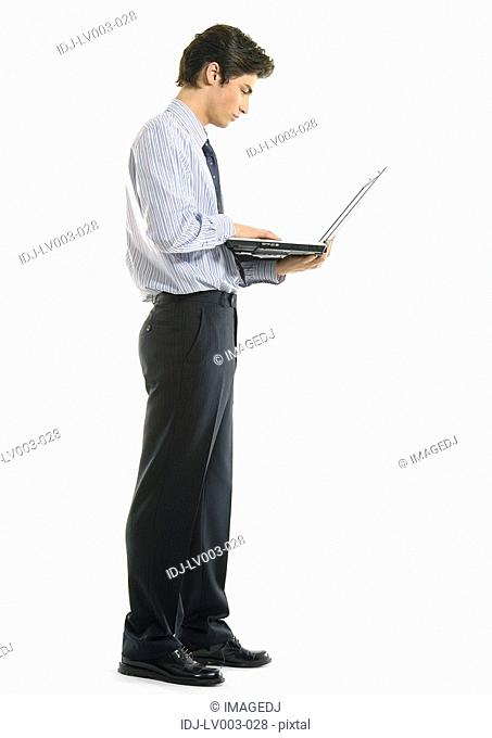 Side profile of a businessman using a laptop