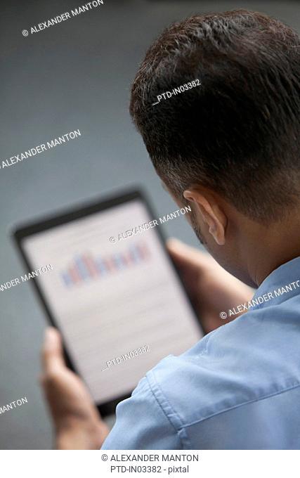 Singapore, Businessman using digital tablet