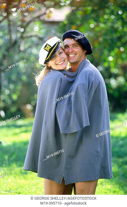 couple in an oversized shirt