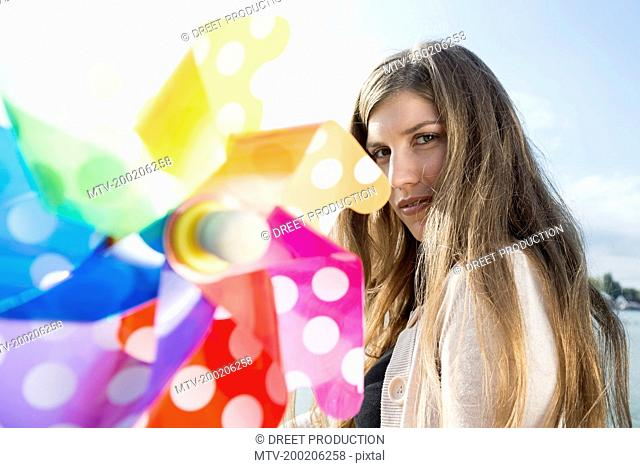 Close up portrait young woman toy windmill
