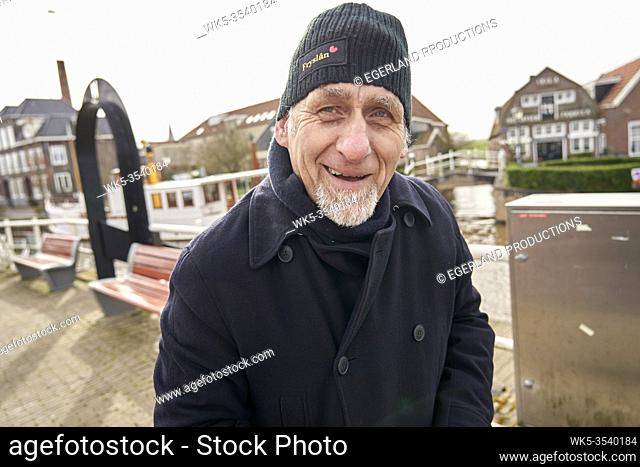 grateful senior man with in Ijlst, Friesland, Netherlands