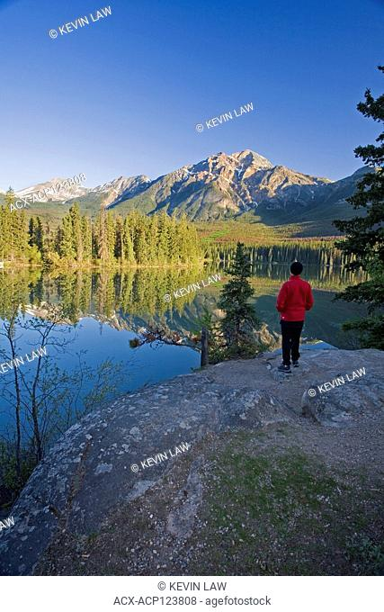 Middle age male early morning at Pyramid Lake, Jasper National Park, ALberta, Canada