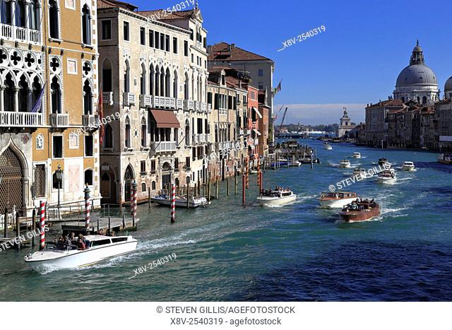 Water taxis on the Grand Canal and Santa Maria della Salute from the Accademia Bridge, Venice, Italy