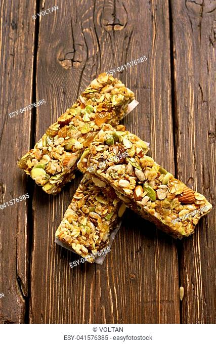 No baked granola bar. Healthy energy snack on wooden background. Top view