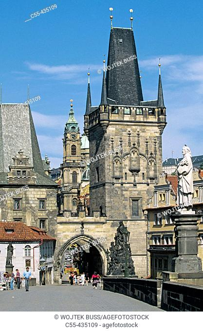 Charles Bridge. (Karluv Most). Saint Mikulase church. Prague. Czech Republic
