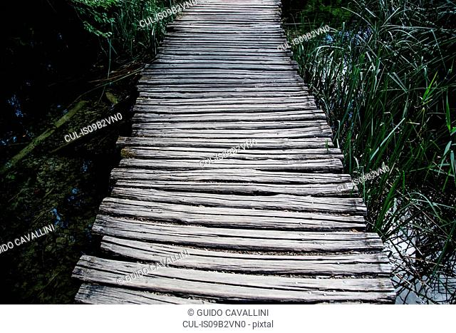 Rustic wooden bridge in reeds at Plitvice Lakes National Park, Croatia