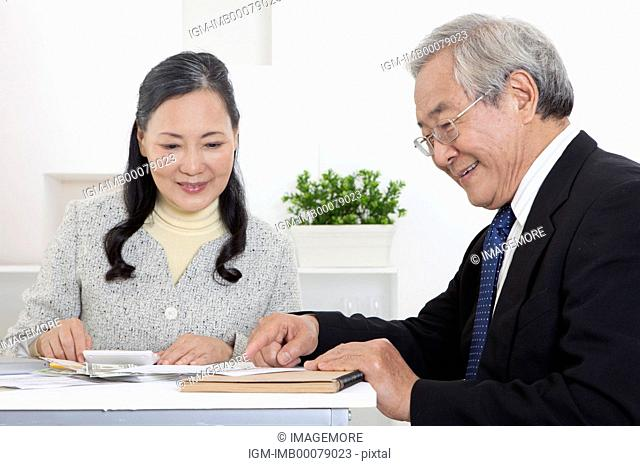 Senior couple discussing financial investment together