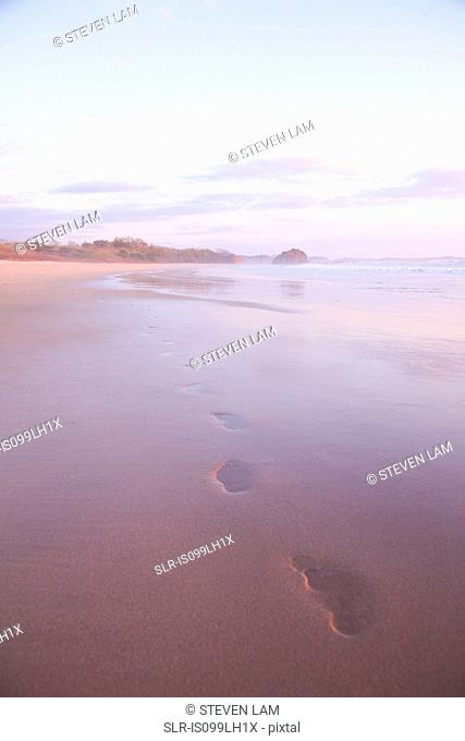 Footprints in sand at sunset, Playa Grande, Santa Cruz, Costa Rica