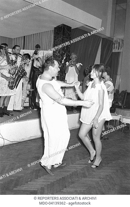 Couple dancing in a club. 1960