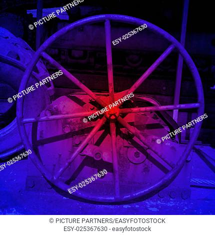 Metal wheel in blue and red light