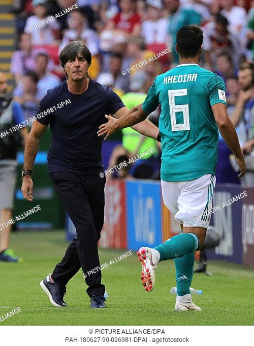 27 June 2018, Russia, Kazan: Soccer, FIFA World Cup, group F preliminary, Germany vs South Korea at the Kazan-Arena. Germany's trainer Joachim Loew (l) and...