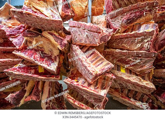 Large cuts of meat hanging for processing , Baltimore, Maryland, USA