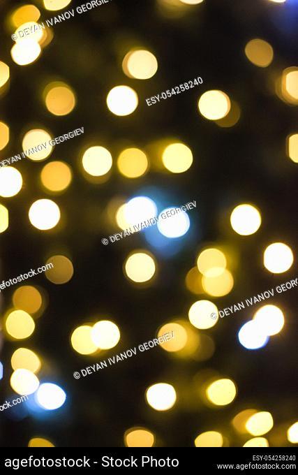 Christmas lights in shopping center. Bokeh
