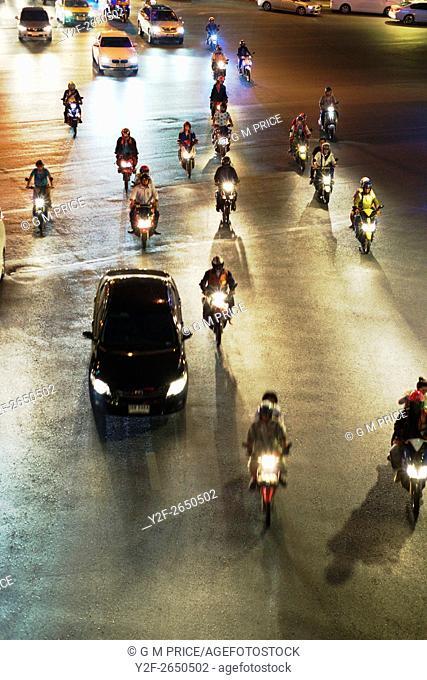 motorcycle and car headlights crossing Rama IV Rd, Bangkok